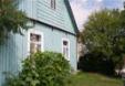 Stary derwniany dom w zielonym kolorze